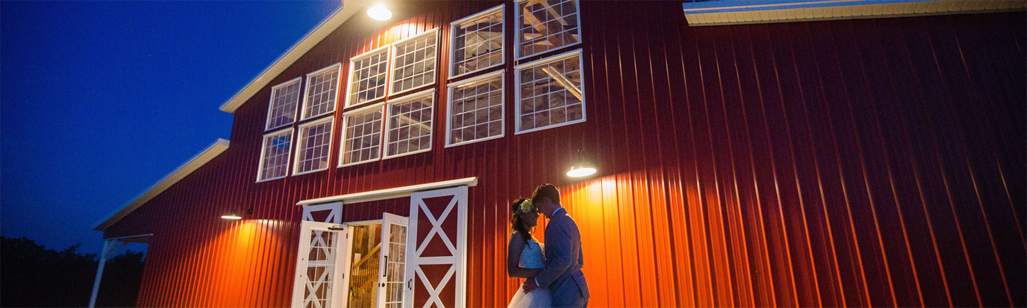 wedding barn at night with bride and groom