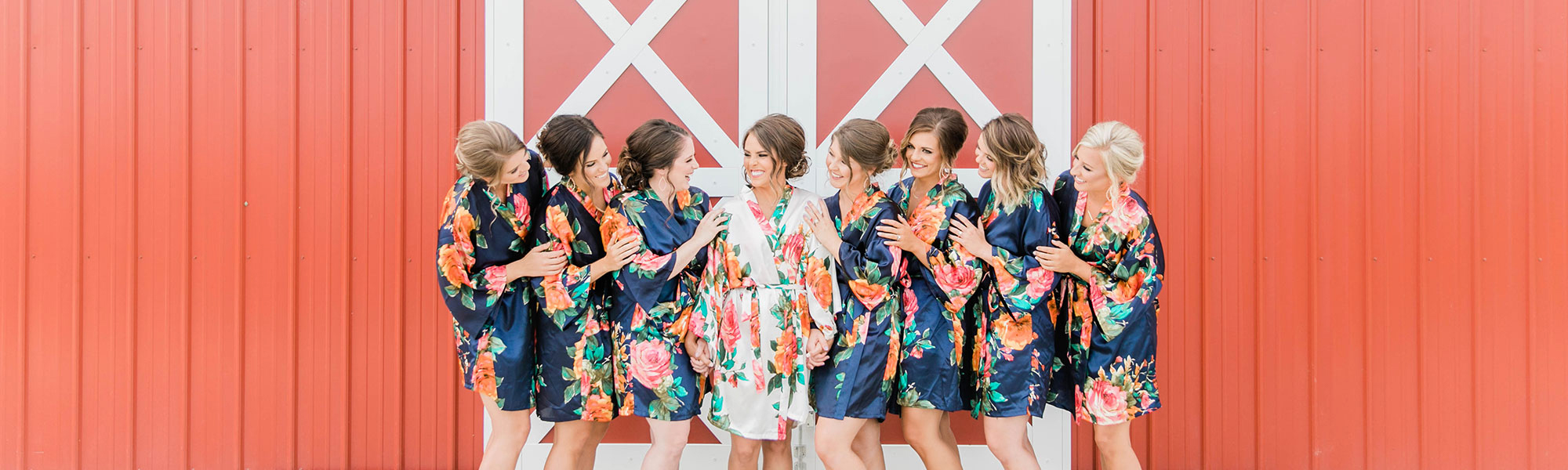 bridal party in front of barn doors